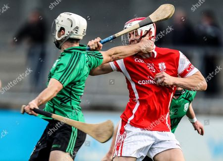 Stock Image of Cuala vs Lucan Sarsfields. Cuala's Con O'Callaghan is fouled by Barry Aird of Lucan