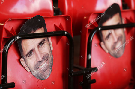 Stock Image of Ex Southampton player Francis Benali masks can be seen it the stands in celebration of his completion of a 1,000+ mile marathon between 44 football grounds in aid of Cancer Research before the Premier League match between Southampton and Burnley played at St Mary's Stadium, Southampton on 16th October 2016