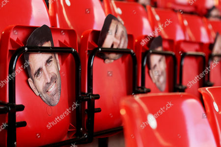 Ex Southampton player Francis Benali masks can be seen it the stands in celebration of his completion of a 1,000+ mile marathon between 44 football grounds in aid of Cancer Research before the Premier League match between Southampton and Burnley played at St Mary's Stadium, Southampton on 16th October 2016