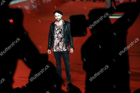 Director Paul Dugdale poses for photographers as he arrives on the red carpet on the occasion of the screening of his movie ' The Rolling Stones Ole' Ole' Ole'!: A trip Across Latin America ' at the Rome Film festival in Rome
