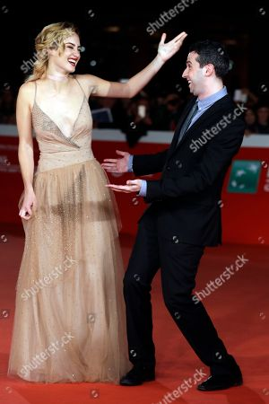 Actress Grace Van Patten and director Adam Leon pose for photographers on the red carpet on the occasion of the screening of the movie ' Tramps ' at the Rome Film festival in Rome