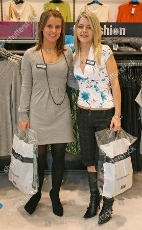 Stock Photo of Coleen McLoughlin helps competition winner Shelly Wareham pick an outfit at the George store in Southend, Essex