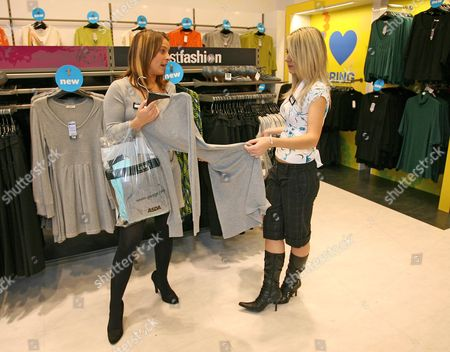 Stock Image of Coleen McLoughlin helps competition winner Shelly Wareham pick an outfit at the George store in Southend, Essex