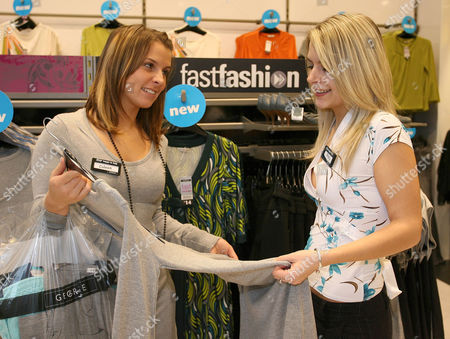 Coleen McLoughlin helps competition winner Shelly Wareham pick an outfit at the George store in Southend, Essex