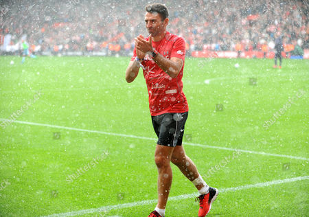 Francis Benali, ex-Southampton player completes his charity event in the downpour during half time, during the Premier League match between Southampton and Burnley at St. Marys on 16th October 2016.