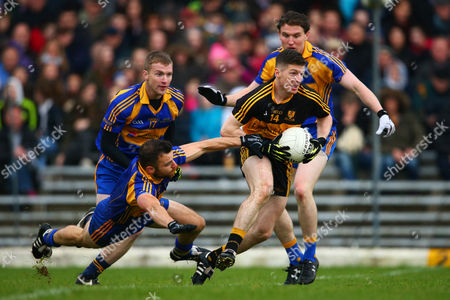 Dr. Crokes vs Kenmare District. Dr. Crokes' Kieran O?Leary under pressure from Dara Crowley, Kevin O?Sullivan and Tadhg Morley of Kenmare District