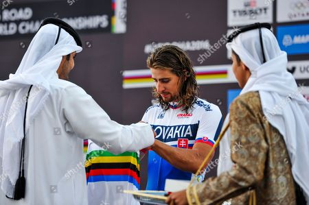 Peter Sagan, Joaan bin Hamad bin Khalifa Al Thani Gold medalist Peter Sagan of Slovakia, right receives the striped shirt, from his Excellency Sheikh Joaan bin Hamad bin Khalifa Al Thani, President of the Qatar Olympic Committee, left, after winning the men's Elite Road Race at the 2016 Road World Championships in Doha, Qatar