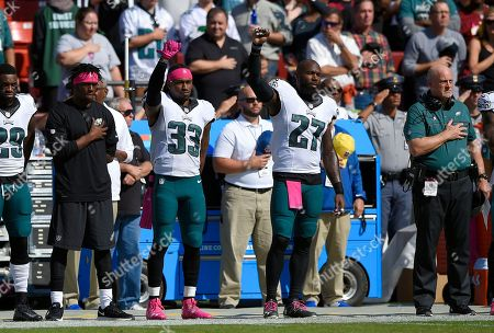 Malcolm Jenkins, Ron Brooks Philadelphia Eagles cornerback Ron Brooks (33) and strong safety Malcolm Jenkins (27) raise their fists during a rendition of the national anthem before an NFL football game against the Washington Redskins, in Landover, Md