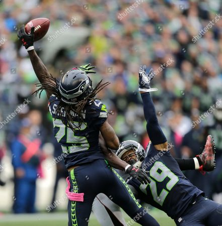 Richard Sherman, Earl Thomas Seattle Seahawks cornerback Richard Sherman (25) and Earl Thomas (29) break up a pass intended for Atlanta Falcons wide receiver Julio Jones (obscured) in the second half of an NFL football game, in Seattle. The Seahawks defeated the Falcons 26-24