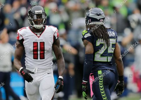 Richard Sherman, Earl Thomas Atlanta Falcons wide receiver Julio Jones (11) reacts after Seattle Seahawks cornerback Richard Sherman (25) broke up a pass play intended for him in the second half of an NFL football game, in Seattle