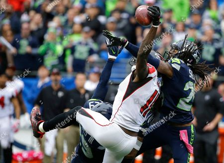 Richard Sherman, Julio Jones Seattle Seahawks cornerback Richard Sherman, right, and Earl Thomas (obscured) break up a pass intended for Atlanta Falcons wide receiver Julio Jones (11) in the second half of an NFL football game, in Seattle. The Seahawks beat the Falcons 26-24