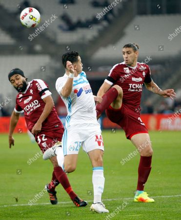 Stock Photo of Florian Thauvin, Benoit Assou-Ekotto, Guido Milan Marseille's Florian Thauvin, center, challenges for the ball with Metz's Benoit Assou-Ekotto, left, and Guido Milan during the French League One soccer match between Marseille and Metz, at the Velodrome Stadium, in Marseille, southern France