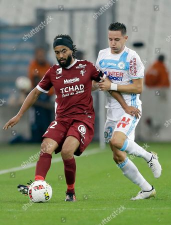 Florian Thauvin, Benoit Assou-Ekotto Marseille's Florian Thauvin, right, challenges for the ball with Metz's Benoit Assou-Ekotto during the French League One soccer match between Marseille and Metz, at the Velodrome Stadium, in Marseille, southern France