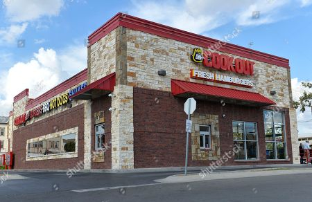 The exterior of the Cook Out restaurant where Trinity Gay, the 15-year old daughter of Olympian and Lexington native Tyson Gay was shot and killed early Sunday morning, in the parking lot of the restaurant, in Lexington, Ky. Lexington police said in a statement that officers went to the parking lot of the restaurant about 4 a.m. Sunday after witnesses reported an exchange of gunfire between two vehicles. Police spokeswoman Brenna Angel said police don't believe Trinity Gay was in either of the vehicles involved