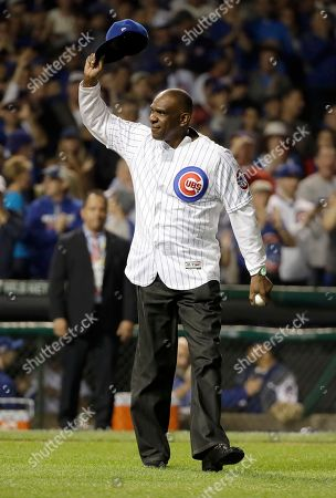 Former Chicago Cubs player Andre Dawson waves to fans before throwing a ceremonial first pitch before Game 2 of the National League baseball championship series between the Chicago Cubs and the Los Angeles Dodgers, in Chicago