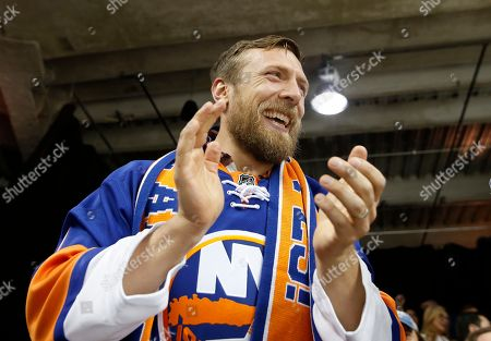 Bryan Lloyd Danielson Retired American professional wrestler Bryan Lloyd Danielson, whose WWE ring name is Daniel Bryan, applauds during the second period of an NHL hockey game between the New York Islanders and the Anaheim Ducks, in New York