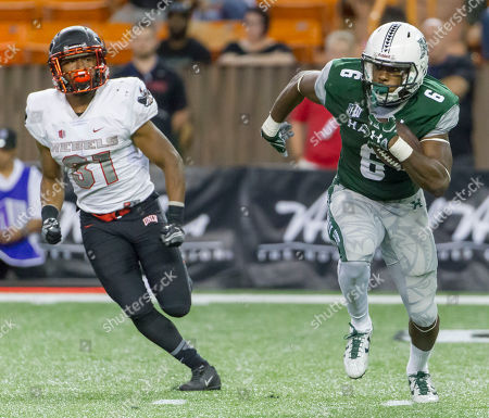 Paul Harris, Salah Boyce Hawaii running back Paul Harris (6) returns a kickoff in the fourth quarter of an NCAA college football game while being chased by UNLV defensive back Salah Boyce (31), in Honolulu. UNLV beat Hawaii 41-38
