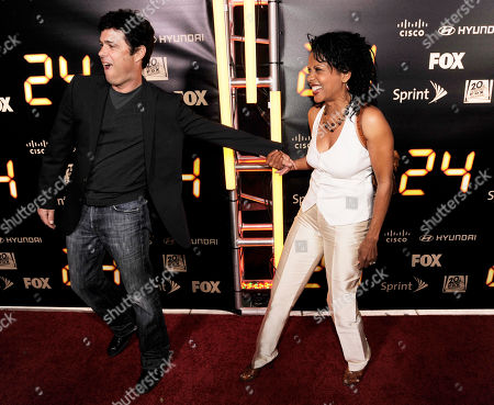 "Caros Bernard, Penny Johnson Jerald Former ""24"" cast members Carlos Bernard, left, and Penny Johnson Jerald interact on the red carpet at he ""24"" Series Finale Party in Los Angeles"