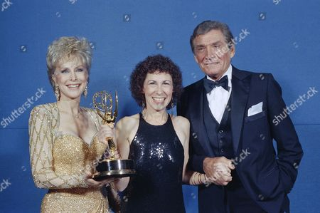 Stock Photo of Barbara Eden, Rhea Pearlman, Gene Barry Performers Barbara Eden, left, and Gene Barry stand with Emmy winner Rhea Pearlman, center, after the Emmy awards show in Los Angeles in September 1986