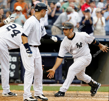 Robinson Cano, Nick Swisher, Jorge Posada New York Yankees' Robinson Cano (24) and Nick Swisher, center, greet teammate Jorge Posada, right, at the plate after Posada's fifth-inning grand slam off Houston Astros reliever Casey Daigle in a baseball game at Yankee Stadium in New York