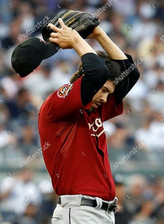 Casey Daigle Houston Astros reliever Casey Daigle reacts on the mound after giving up a fifth-inning grand slam to New York Yankees' Jorge Posada in a baseball game at Yankee Stadium in New York