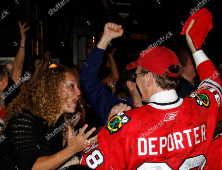 Chicago Blackhawks fans in Chicago celebrate after the Chicago Blackhawks defeated the Philadelphia Flyers 4-3 during Game 6 of the NHL Stanley Cup hockey finals in Philadelphia