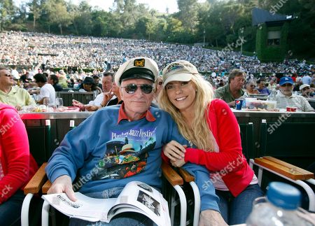 """Hugh Hefner, Anna Berglund Playboy impresario Hugh Hefner and Anna Berglund share a front row center box in a capacity crowd at the 32nd annual Playboy Jazz Festival at the Hollywood Bowl in Los Angeles.The new book """"Playboy Swings"""" releasing Sept. 14, 2015, details Hefner's contribution to popularizing jazz and his stand against racial segregation in entertainment"""