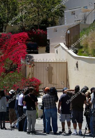 Members of the media await for family news outside the home of actress Brittany Murphy's husband British screenwriter Simon Monjack, in Los Angeles. Police say Monjack was found dead at his Los Angeles home late Sunday, May 23, 2010, five months after his wife, actress Brittany Murphy, died