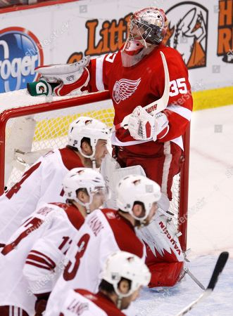 Jimmy Howard Detroit Red Wings goalie Jimmy Howard (35) reaches for his drink as Phoenix Coyotes, from center left and down, Taylor Pyatt, Radim Vrbata, Keith Yandle and Robert Lang skate back to the bench after Vrbata's goal during the second period in a first-round NHL playoff hockey game in Detroit