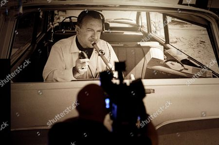 A display showing Walter Cronkite broadcasting from the back of car is seen in a display at the Walter Cronkite exhibit at the LBJ Library, in Austin, Texas