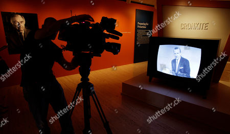 Vintage news reel is seen in a display at the Walter Cronkite exhibit at the LBJ Library, in Austin, Texas