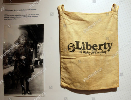 A bag used by Walter Cronkite to sell Liberty magazines is seen in a display at the Walter Cronkite exhibit at the LBJ Library, in Austin, Texas