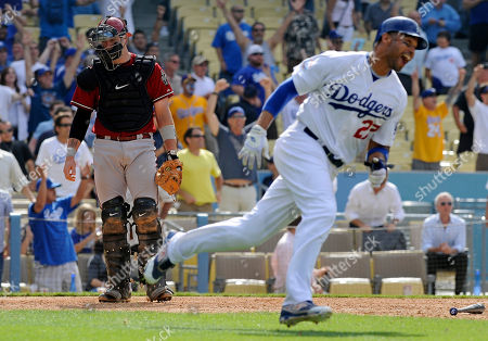 Matt Kemp, Chris Snyder Los Angeles Dodgers' Matt Kemp, right, celebrates after scoring the game-winning run on a Garret Anderson RBI single as Arizona Diamondbacks catcher Chris Snyder walks off the field in the 14th inning of a baseball game, in Los Angeles. The Dodgers won 1-0 in 14 innings