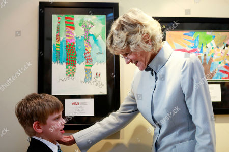 """Jalyn Weston, Jean Kennedy Smith Jalyn Weston, 7, left, of Sweetwater, Tenn., is greeted by Jean Kennedy Smith """"State of the Art"""" exhibit, part of the International VSA Arts Festival, at Union Station in Washington, on"""