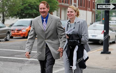 Stephen Schneider, Linda Schneider FILE - In this May 10, 2010 photo, Dr. Stephen Schneider and his wife, Linda, of Haysville, Kan., leave the Federal Courthouse in Wichita, Kan. The Kansas doctor, accused of illegally prescribing drugs linked to 68 deaths, testified, that he knew some patients had died from overdoses, but he said his clinic changed its practices to prevent future overdoses. Schneider and his wife, Linda, are charged in a 34-count indictment with illegally prescribing drugs and committing health care fraud and money laundering