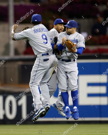Reed Johnson, Matt Kemp, Garret Anderson Los Angeles Dodgers' Garret Anderson, left, Reed Johnson, right, and Matt Kemp celebrate after their 4-1 victory over the San Diego Padres in a baseball game, in San Diego