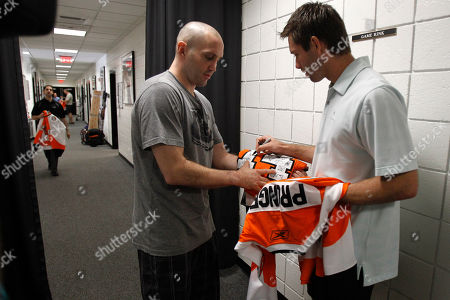 Brian Boucher, Ian Laperriere Philadelphia Flyers' Brian Boucher, right, signs a jersey for teammate Ian Laperriere at the team's practice facility, in Voorhees, N.J. The Flyers lost to the Chicago Blackhawks in the NHL Stanley Cup hockey finals