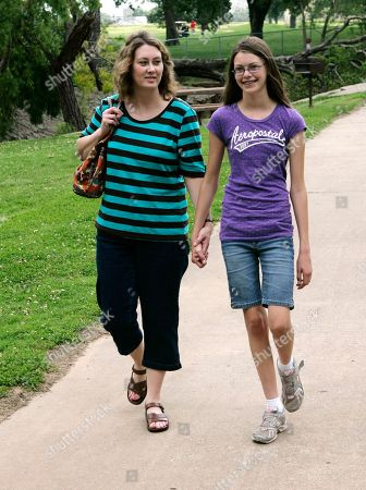 Belinda Johnson, Shiloh Johnson In this photo shot, Belinda Johnson, left, poses for a photograph with her daughter, Shiloh, right, in a park in Tulsa, Okla