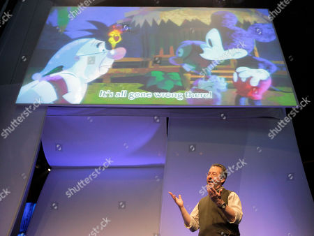 """Warren Spector, general manager and creative director of Disney Interactive Studios' Junction Point, speaks during a presentation on """"Epic Mickey"""" video game, at the Disney booth during the E3 Expo in Los Angeles"""