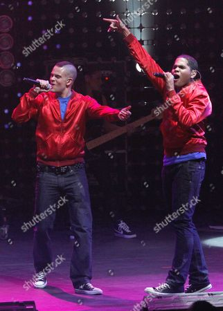 """Mark Salling, Dijon Talton Cast members of the television show """"Glee"""" Mark Salling, left, and Dijon Talton perform during a concert to kickoff a national """"Glee"""" tour at the Dodge Theatre, in Phoenix"""