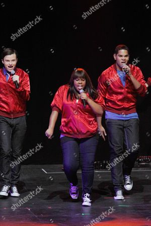 """Amber Riley, Chris Colfer, Dijon Talton Cast members, Amber Riley, front, Chris Colfer, left, and Dijon Talton, of the television show """"Glee"""" perform during a concert to kickoff a national """"Glee"""" tour at the Dodge Theatre, in Phoenix"""