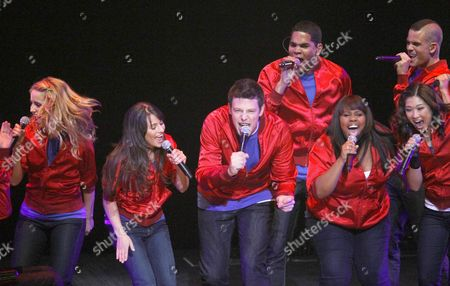 """Dianna Agron, Lea Michele, Cory Monteith, Dijon Talton, Amber Riley, Jenna Ushkowitz, Mark Salling From left to right, cast members of the television show """"Glee"""", Dianna Agron, Lea Michele, Cory Monteith, Dijon Talton, Amber Riley, Jenna Ushkowitz, and Mark Salling, perform during a concert to kickoff a national """"Glee"""" tour at the Dodge Theatre, in Phoenix"""