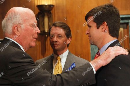 """Patrick Leahy, Keith Jones, Christopher Jones Senate Judiciary Committee Chairman Patrick Leahy, D-Vt., left, talks with Christopher Jones, right, as his father Keith Jones looks, on Capitol Hill in Washington, prior to the committee's hearing on """"The Risky Business of Big Oil: Have Recent Court Decisions and Liability Caps Encouraged Irresponsible Corporate Behavior?. Keith's son and Christopher's brother Gordon Jones was one of the 11 people killed following the Deepwater Horizon oil rig explosion"""