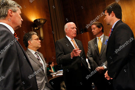 """Sheldon Whitehouse, Al Franken, Patrick Leahy, Keith Jones, Christopher Jones Senate Judiciary Committee Chairman Patrick Leahy, D-Vt. center, accompanied by Sen. Sheldon Whitehouse, D-R.I., left, and Sen. Al Franken, D-Minn., second from left, speaks with Keith Jones, second from right, and Christopher Jones, on Capitol Hill in Washington, prior to the committee's hearing on """"The Risky Business of Big Oil: Have Recent Court Decisions and Liability Caps Encouraged Irresponsible Corporate Behavior?. Keith's son and Christopher's brother Gordon Jones was one of the 11 people killed following the Deepwater Horizon oil rig explosion"""