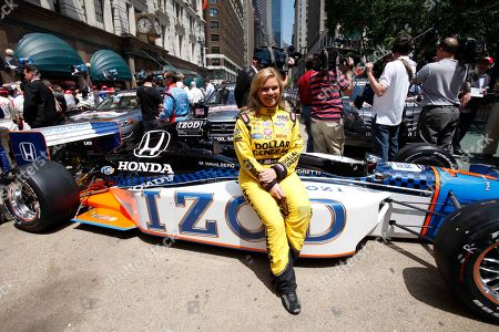 Sarah Fisher Driver Sarah Fisher sits on a car during an event to promote the upcoming Indianapolis 500 auto race, in New York, . The race is scheduled for Sunday, May 30