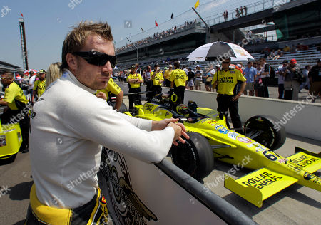 Jay Howard Jay Howard, of England, watches as he car owner and teammate Sarah Fisher sits in her car on the final day of qualifications for the Indianapolis 500 auto race at the Indianapolis Motor Speedway in Indianapolis