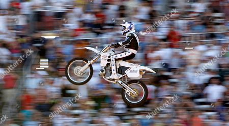 Stock Image of Kaptain Robbie Knievel Kaptain Robbie Knievel flies on his motorcycle for a jump before the start of the IRL Firestone 550 auto race at the Texas Motor Speedway in Fort Worth, Texas