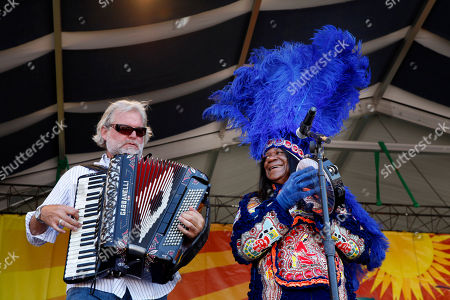 Monk Boudreaux, Johnny Sansone Big Chief Monk Boudreaux, head of the Golden Eagles Mardi Gras Indians, and Johnny Sansone, left, perform with the Voice of the Wetlands All Stars at the New Orleans Jazz and Heritage Festival in New Orleans