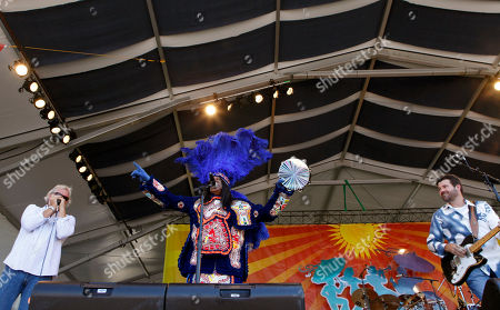Monk Boudreaux, Johnny Sansone, Tab Benoit Big Chief Monk Boudreaux, head of the Golden Eagles Mardi Gras Indians, performs with the Voice of the Wetlands All Stars at the New Orleans Jazz and Heritage Festival in New Orleans, . Left is Johnny Sansone, and right is Tab Benoit