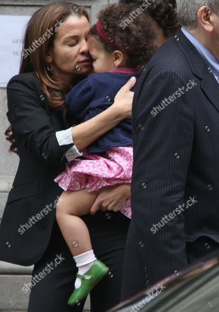 """Jenny Lumet embraces her daughter Sasha, 2, at the funeral service for her grandmother, entertainer and civil rights activist Lena Horne, at Church of St. Ignatius Loyola in New York, . Horne, known for her signature song """"Stormy Weather"""" and for her triumph over bigotry, died Sunday in New York. She was 92"""